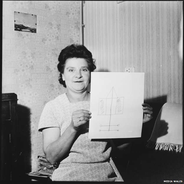 Mrs James with her drawing of a UFO