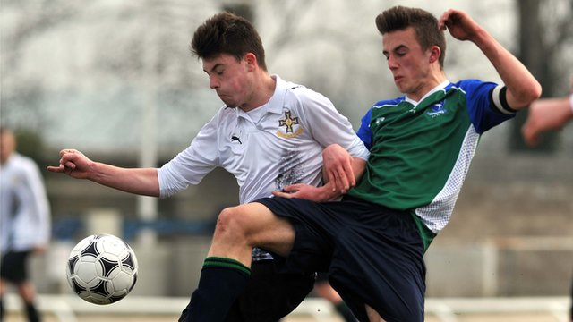 Action from the final between Edmund Rice College and Grosvenor Grammar