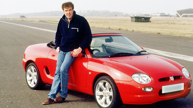 Jeremy Clarkson stands by red sports car
