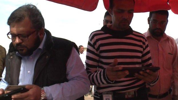Sim card registration in the village of Tirkhi Nangyal, Pakistan