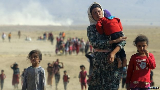 Displaced people from the minority Yazidi sect, fleeing violence from forces loyal to the Islamic State in Sinjar town - August 11, 2014