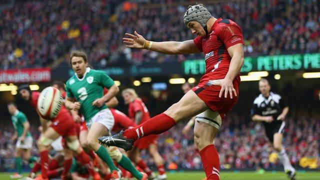 Wales' Jonathan Davies kicks the ball against Ireland