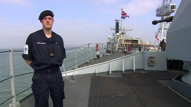 A seaman in the new Navy uniform