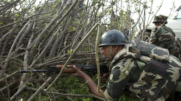 Indian paramilitary soldiers take position in Kathua district on March 20, 2015