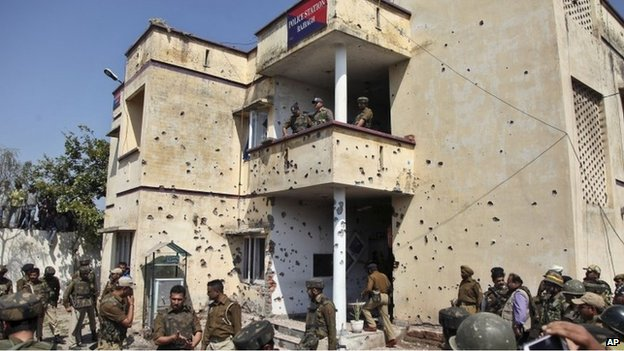 Bullet marks from a rebel attack are seen on the walls of Rajbagh police station in Kathua district on March 20, 2015.