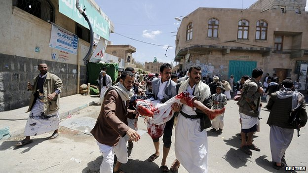 Injured man carried from scene of bombing in Sanaa. 20 March 2015