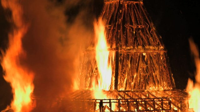 Wooden temple in flames