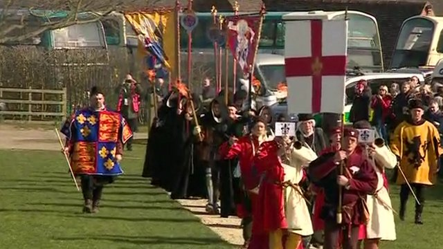 Historians in Tudor costumes carrying flags