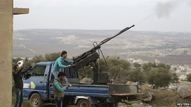 File photo: A rebel fighter from the Ahrar al-Sham Islamic Movement fires an anti-aircraft weapon in Jabal al-Zawiya, Idlib, 27 January 2015
