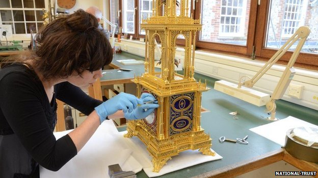 West Dean College staff cleaning the clock