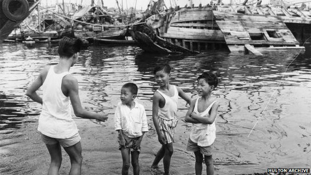 Children by the Singapore harbour in 1963