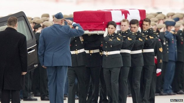 Honor guards carry the coffin of Sergeant Andrew Joseph Doiron to a hearse at CFB Trenton 10 March 2015