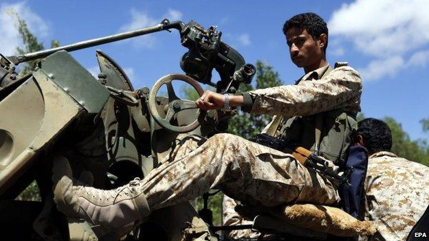 A Houthi fighter mans a machine gun in Sanaa, Yemen (24 March 2015)