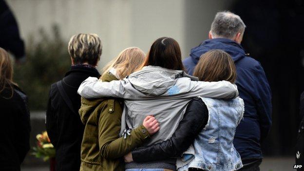 Pupils hug each other at Joseph Koenig school. Photo: 25 March 2015