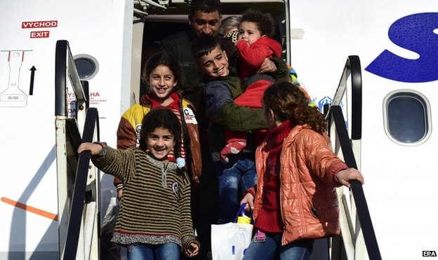 A Syrian refugee family disembarks from a plane on the airport Hannover-Langenhagen, in Langenhagen, Germany, 11 March 2015