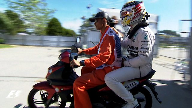 Lewis Hamilton hitches a ride back to the pits