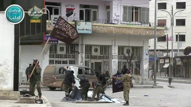 Holding a flag in Idlib
