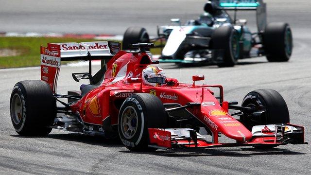 Sebastian Vettel leads Nico Rosberg at Sepang