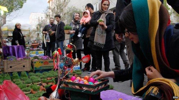 Iranians go shopping at a street market