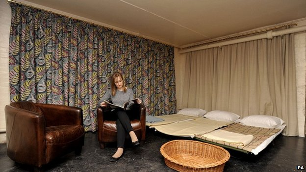 A model reads in the bunker in Eltham Palace