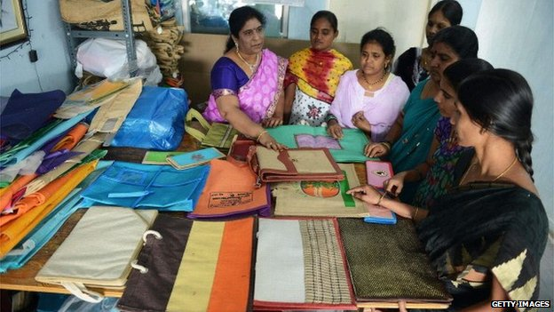 Women learn how to make bags during a workshop in Hyderabad