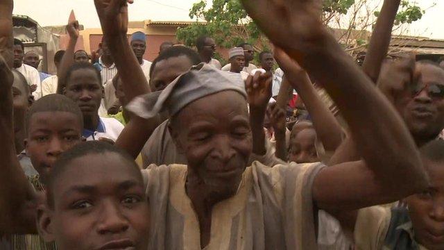 Nigerians from Daura celebrate Buhari's presidential win.