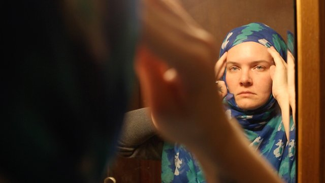Jessey Eagan adjusts her hijab