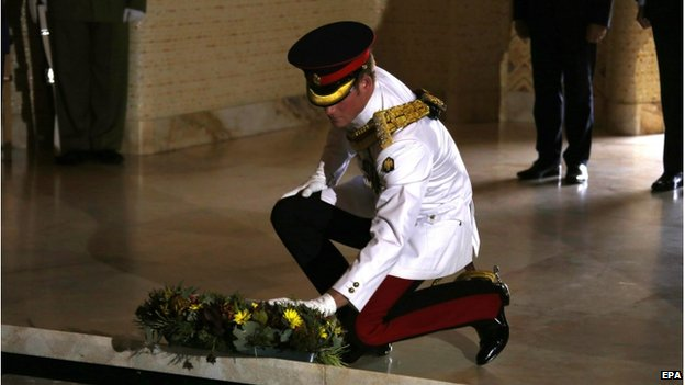 Prince Harry laying a wreath