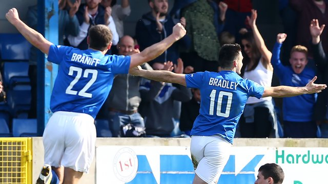 Glenavon's Kevin Braniff and Eoin Bradley celebrate a 5-0 victory over Cliftonville