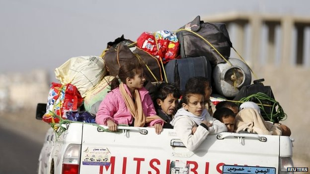 Children in a pick-up truck fleeing Saudi-led air strikes in the Yemeni capital Sanaa