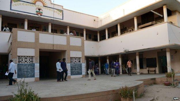 Indian pupils walk at Maharaj Shree Bhagwatacharya Narayanacharya (B N) High School, where Indian prime minister Narendra Modi studied, in Vadnagar town, some 110 kms from Ahmedabad.