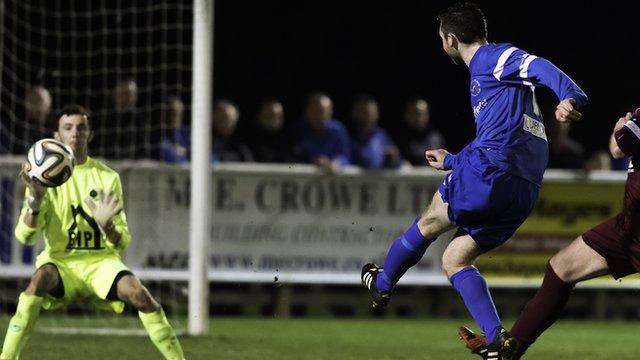 Jason McCartney of Ballinamallard scores his second goal against Institute