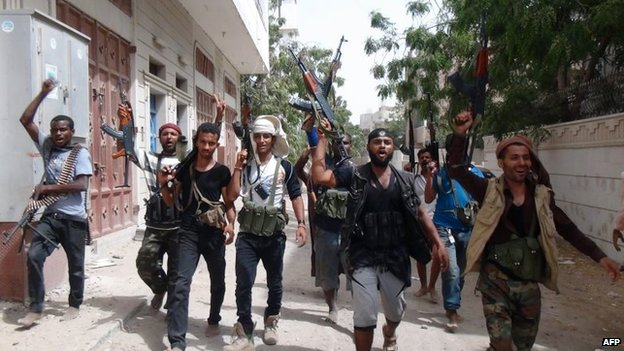Anti-Houthi fighters shout slogans in Aden