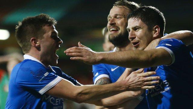 Linfield's Mark Haughey (right) celebrates scoring the winner against Glentoran
