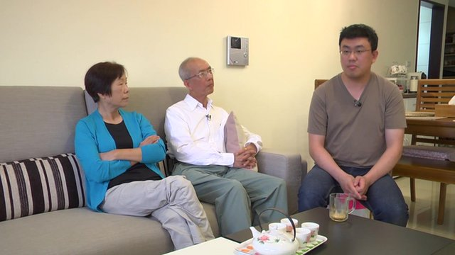 Sunflower Movement member Kevin Wang (r) and his parents