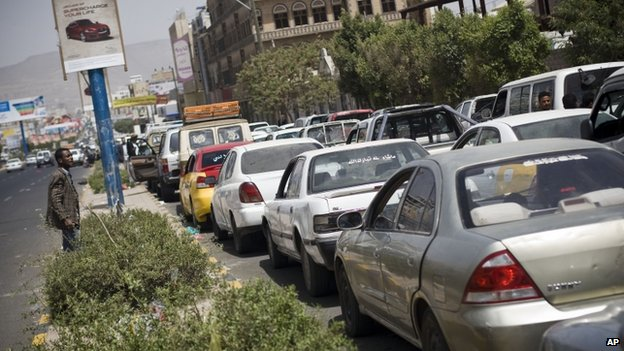 Cars line up in a queue at a petrol station amid fuel shortages in Sanaa, Yemen, Wednesday, April 8, 2015.