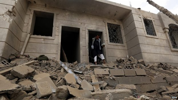 A Yemeni man inspects a house destroyed by an airstrike of the Saudi-led alliance which targeted a Houthi supporters-dominated neighbourhood in Sana'a, Yemen, 08 April 2015