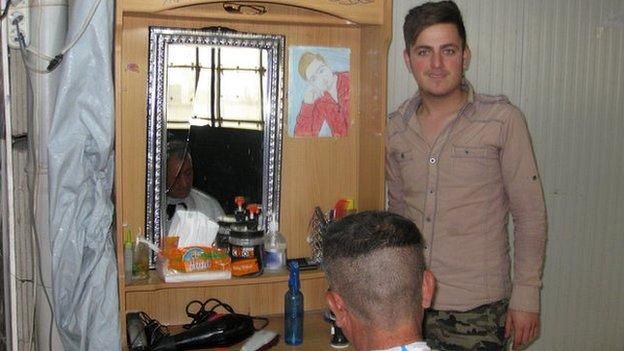 Issa, a barber in a refugee camp in Iraqi Kurdistan