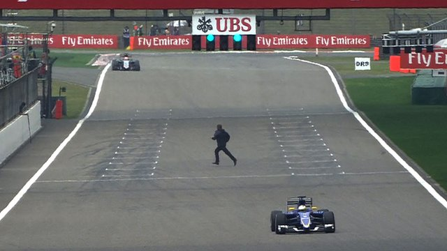 A track invader sprints across he start/finish straight at the Chinese Grand Prix