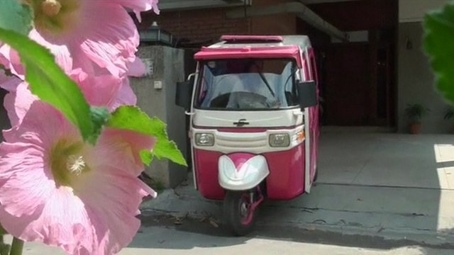 The pink and white auto-rickshaw