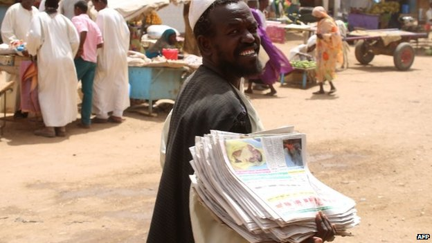 A Sudanese man sells newspapers at a market in Shendi, the hometown of Sudanese President Omar al-Bashir