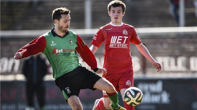 Match action from Glentoran against Portadown