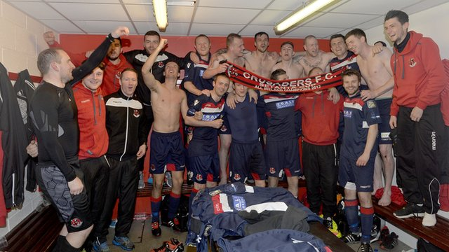Crusaders celebrate after their 1-0 victory over Cliftonville which virtually guarantees them the league title