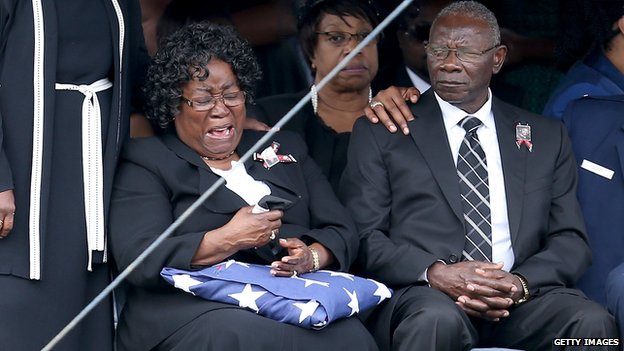 Judy Scott is overcome with emotion during the burial service on 11 April 2015