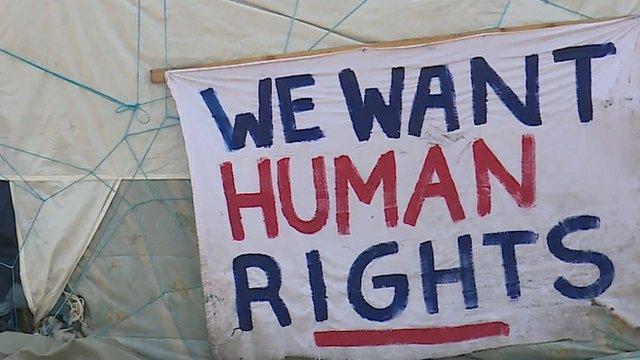 Sign at migrant camp