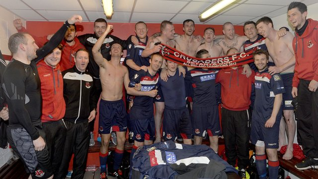 Crusaders celebrate victory over Cliftonville which virtually guarantees them the Premiership title