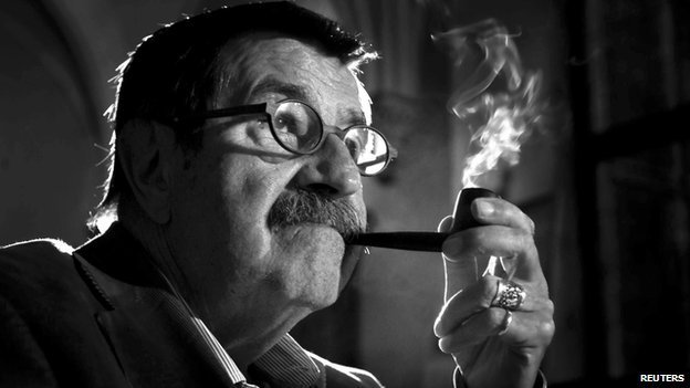 German novelist and winner of the Nobel Prize in Literature Guenter Grass smokes his pipe during a meeting in Gdansk in this September 11, 2005 file picture.