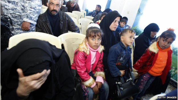 An Iraqi woman whose husband was killed sits with her children listening during a meeting with US Federal Prosecutors to discuss the case against the security firm Blackwater