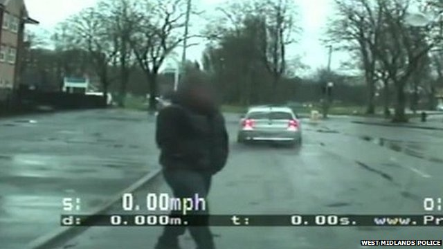 Passenger walking in front the police car as Ali drives off