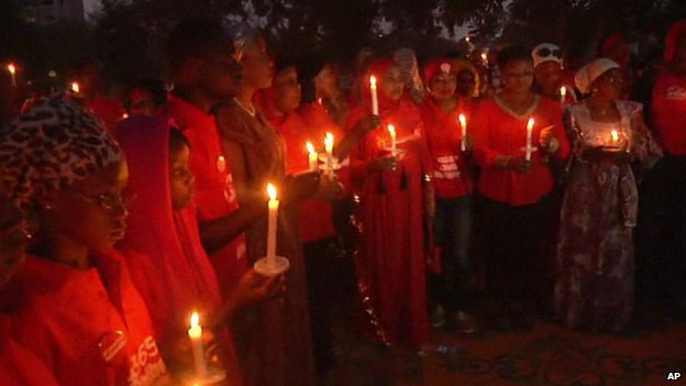 People at a candlelit vigil marking the anniversary of the abductions in Abuja, Nigeria, 14 April 2015